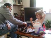 Playing chess with our niece, Serene