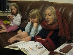 Mum reads to Serene and Zia